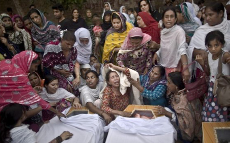 Grieving after a suicide bomb attack in Peshawar, Pakistan
