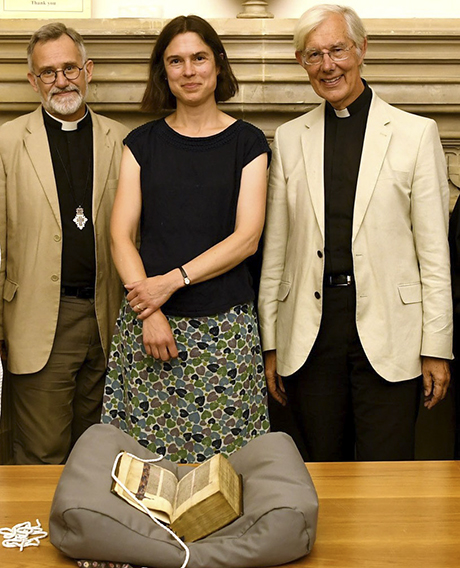 The Lyghfield Bible returns to Canterbury Cathedral much to the delight of (left to right) Canon Librarian, Revd Tim Naish, Head of Archives and Library Mrs Cressida Williams and the Dean of Canterbury, the Very Revd Robert Willis.