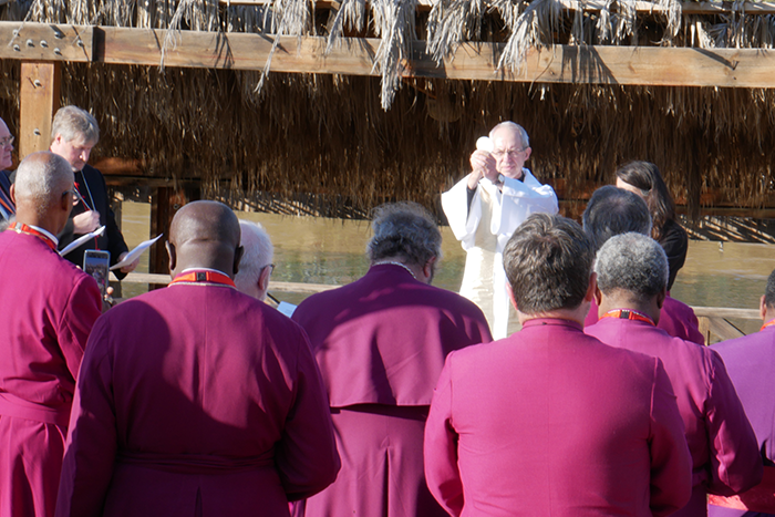 The Archbishop Of Canterbury Leads Worship At The Shores Of The River Jordan